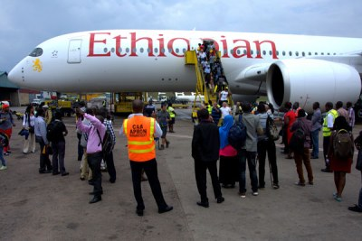 Passengers alight from an Ethiopian Airlines Airbus (file photo).