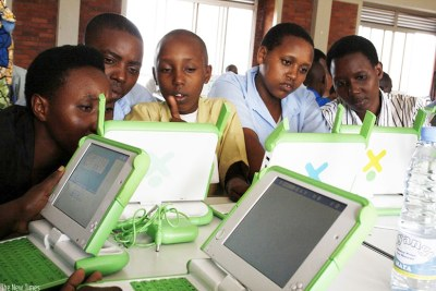 Pupils of Kimisagara Primary School use their laptops (file photo).
