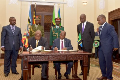 Deal. President Museveni and his Tanzanian counterpart John Pombe Magufuli sign the East African Crude Oil Pipeline Agreement in Dar es Salaam yesterday. The agreement was an expression of intent to go ahead with the construction of the 1,4445km oil pipeline from Hoima District in western Uganda to the Tanzanian Port of Tanga.