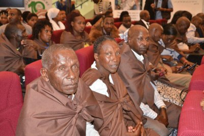 Members of the Ogiek community listen to a ruling by the African Court on Human and Peoples' Rights in Arusha on May 26, 2017.