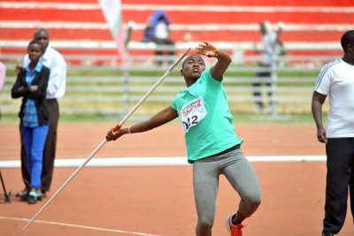 Cynthia Chebet makes a thrown during the World Under -18 Championship trials at Nyayo Stadium .