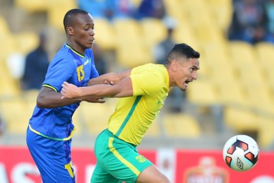 Cole Alexander of South African challenged by Raphael Loth of Tanzania during 2017 Cosafa Castle Cup match between South Africa and Tanzania.