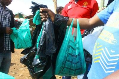 Plastic bag vendors at Kisii fresh produce market on Monday April 17, 2017.