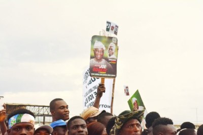Partisans waving their Boakai-Nuquay banners.