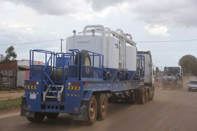 A Tullow Oil truck carrying drilling machines.