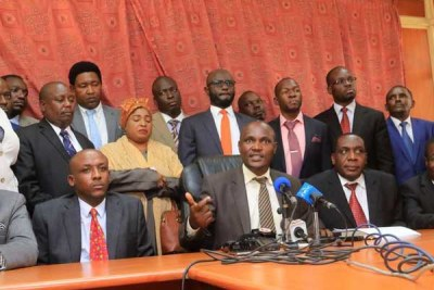 ODM chairperson John Mbadi (centre) addresses journalists after a Nasa parliamentary group meeting on October 10, 2017.