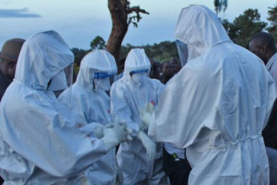 Health experts bury a Marburg victim on October 26, 2017 in Kween District, Uganda.