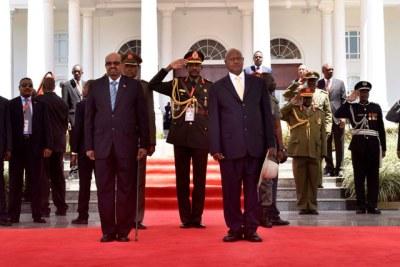 President Yoweri Museveni, right, and Sudan's Omar al-Bashir, left, at State House on November 13, 2017.