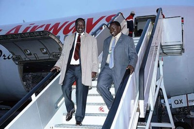 Raila Odinga (left) disembarks from a plane at JKIA (file photo).