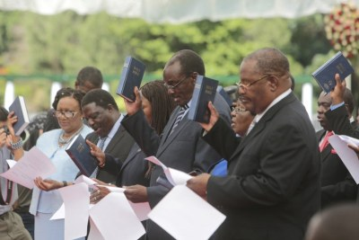 Cabinet ministers take their oath of office before President Emmerson Mnangagwa in 2017 (file photo).