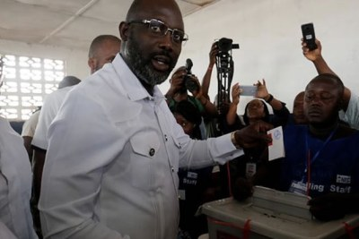 George Weah votes.