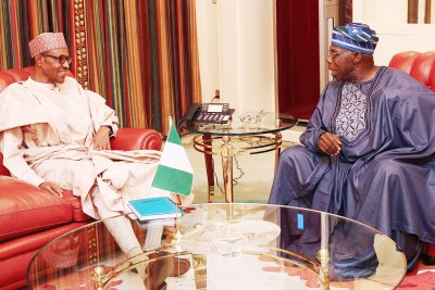 President Buhari in a meeting with Obasanjo (file photo).