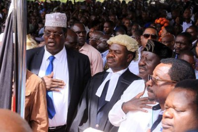 Nasa leader Raila Odinga, flanked by lawyers Miguna Miguna, TJ Kajwang and James Orengo during the swearing in ceremony at Uhuru Park.
