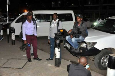 Journalists camp outside Nation Centre on January 31, 2018 following reports that police wanted to arrest NTV Managing Editor Linuis Kaikai.