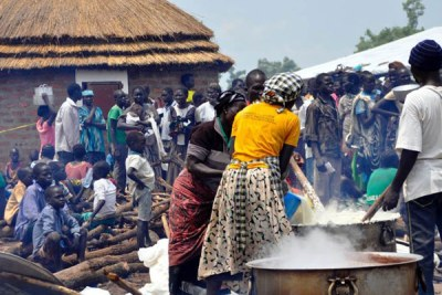 Refugees prepare a meal in Pagirinya Settlement in Adjumani District recently (file photo).
