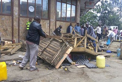 City askaris dismantle woodens stands used by hawkers in the city centtre during a stong operation.