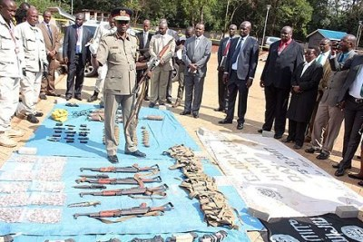Inspector General of Police Joseph Boinnet, at the DCI headquarters in Nairobi on March 14, 2018, displays the firearms and ammunition confiscated from terror suspects in Isiolo.