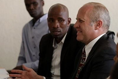 Amazing Grace Radio proprietor (right) Gregory Ryan Shoof explains himself before Rwanda Media Commission in February 2018.