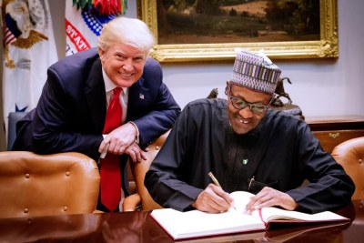 President Muhammadu Buhari signing the White House register after his arrival at the White House for a meeting with President Donald Trump on Monday, April 30, 2018.