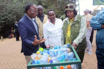 Environment Cabinet Secretary Judy Wakhungu (right) with chairman of Friends of Karura Karanja Njoroge during plastic clean-up in September 2017.
