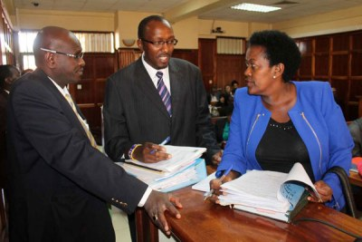 From left: Lawyers James Njiha, Peter Munge and Judy Thong'ori, representing children of the late spymaster James Kanyotu, discuss at the High Court on March 14, 2015 about the case in which the children are seeking control of their father's empire.