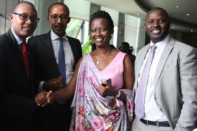 Former City of Kigali acting mayor Parfait Busabizwa (left) shakes hands with newly-elected mayor Marie-Chantal Rwakazina, as the president of the Advisory Council Anastase Rutabingwa (2nd left) and his deputy Janvier Gasana look on.