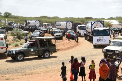 A police vehicle escorts trucks loaded with crude oil from Ngamia 8 oil fields in Turkana County on June 3, 2018.