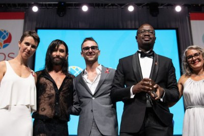 Allan Achesa Maleche (in black suit) was named the pro-bono lawyer of the year by the International AIDS Society.