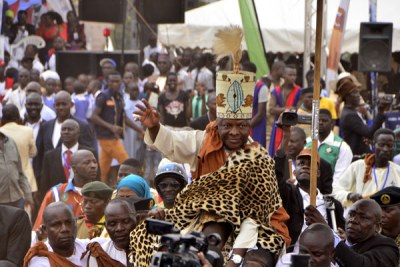 Loyalists carry Kabaka Ronald Muwenda Mutebi II shoulder-high to the rostrum during his silver jubilee anniversary of his coronation in Mengo, Kampala.