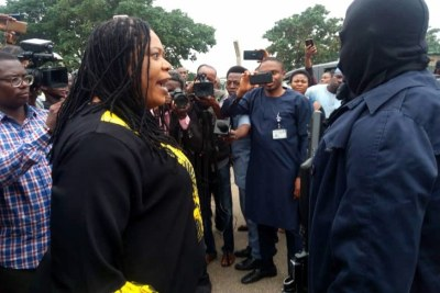 Honourable Boma Goodhead from Rivers State confronts the masked men blocking the National Assembly.