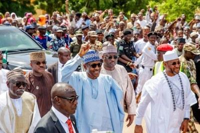 President Muhammadu Buhari walks home from Eid praying ground.