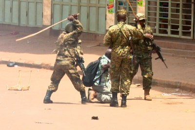 Ugandan soldiers beating up Reuters photojournalist James Akena as he covered the protests over the detention of several Opposition MPs in Kampala.