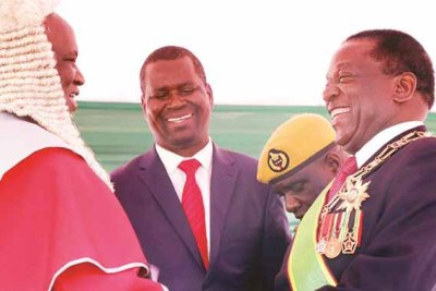 President Emmerson Mnangagwa is congratulated by Chief Justice Luke Malaba after his inauguration at the National Sports Stadium in Harare.