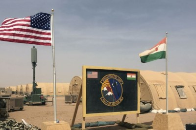 In this photo taken April 16, 2018, a U.S. and Niger flag are raised at the base camp for air forces and other personnel supporting the construction of Niger Air Base 201 in Agadez, Niger.