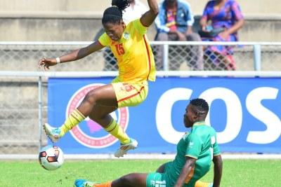 Marjory Nyaumwe of Zimbabwe challenged by Annie Kibanji of Zambia during the 2017 COSAFA Women's Championship football match between Zimbabwe and Zambia at Barbourfields Stadium, Bulawayo.