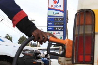 A pump attendant fuels a matatu at a petrol station in Nyeri on September 2, 2018.