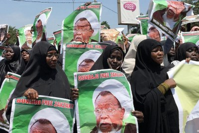 Women in black niqabs holding up posters calling for the release of Shiite cleric Ibrahim Zakzaky. The founder and leader of the Shiite Islamist Movement of Nigeria (IMN), has been in jail since December 2015.