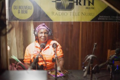 Mama Mwatatu rises early and makes a two-hour trek from her home in Beni's Cité Belge neighbourhood in North Kivu to the local radio station, where women inundate her with questions about the deadly disease.