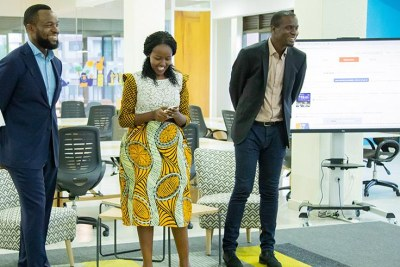 Minister for ICT and Innovation Paula Ingabire (centre) launches the African 'Design Lab'. Looking on are tech-prenuers Bosun Tijani (left), the founder of Co-Creation Hub (CcHub) and Femi Longe (R) the co-founder and head of innovation.
