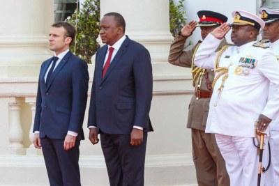 President Uhuru Kenyatta with French President Emanuel Macron in Nairobi (file photo).