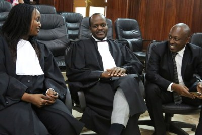 Richard Mugisha (right) consults with his lawyers Moise Nkundabarashi and Florida Kabasinga (left) at the Supreme Court where the landmark ruling in the case filed by Mugisha, challenging some of the provisions in the law that went into force in August, 2018.