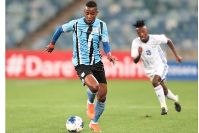 Mothusi Johnson of Botswana challenged by Tumelo Khutlang of Lesotho during the 2019 Cosafa Cup semifinals match between Lesotho and Botswana.