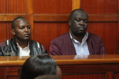 Blogger Robert Alai and his co-accused Mr Patrick Safari in a Nairobi court on June 19, 2019.