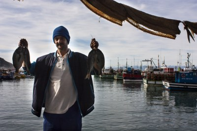 Pollution on our plate: Kalk Bay fisher Michael Howell holds up a brace of Cape bream. A recent scientific study has found these and other fish landed at Kalk Bay contain pharmaceutical and industrial chemical compounds in their flesh as a result of ocean pollution.