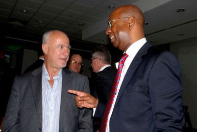 Safaricom's founding chief executive Michael Joseph (left) with the late Bob Collymore who succeeded him at the telecom giant (file photo).