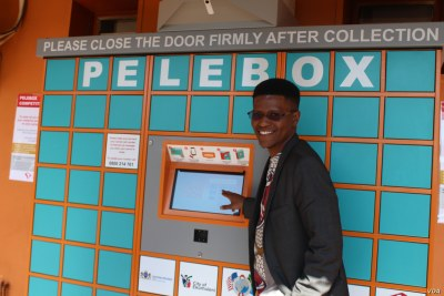 Inventor Neo Hutiri poses in front of one of his Peleboxes.