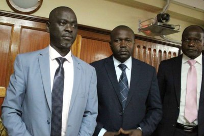 Migori Governor Okoth Obado (R), his personal assistant Michael Oyamo (C) and County Clerk Casper Obiero in a Nairobi Court on May 29, 2019, during the hearing of an application for judge Jessie Lessit to recuse herself from the case.