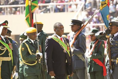 Commander-in-Chief of the Zimbabwe Defence Forces President Mnangagwa and Commander Zimbabwe Defence Forces General Phillip Valerio Sibanda inspect a parade during Zimbabwe Defence Forces Day celebrations in Harare (file photo).