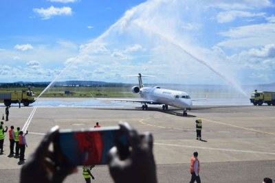 One of the new planes is saluted with water jets on landing at Entebbe airport.