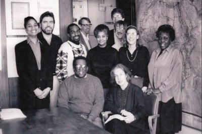 Staff of the American Committee on Africa (ACOA) and The Africa in 1992. From left to right standing: Aleah Bacquie, Michael Fleshman, Adotei Akwei, Sandy Boyer, Annie King, Jim Cason, Richard Knight, Rachael Kagen, and Deloris Ripley. From left to right seated: Dumisani Kumalo and Jennifer Davis. This photograph was digitized from the program for Annie King's memorial service at One Way Church of Christ on February 22, 2013. <i>Used by permission of Africa Action (successor to the American Committee on Africa and The Africa Fund).</i>
